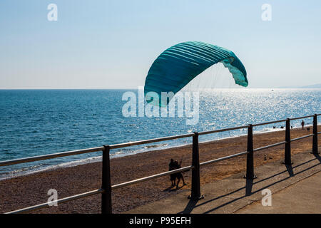 Paraglider having a lesson on the beach at West Bay, Dorset, UK. - Stock Image