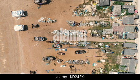 Aerial top down view of fishing boats on the beach in Hastings, England - Stock Image