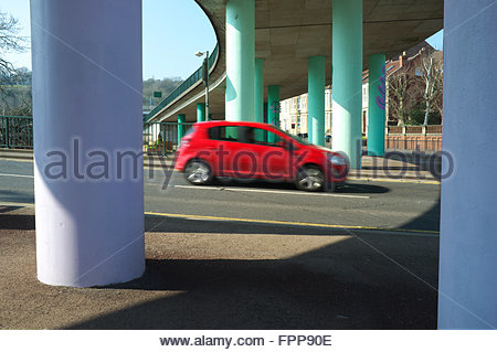 The 1960's built Cumberland Basin flyover, with colourful concrete support pillars for the road above. Bristol, - Stock Image