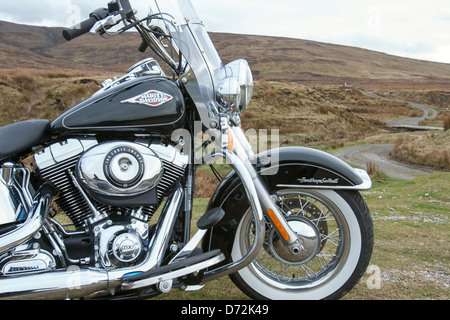 Harley Davidson FLSTC Softail Heritage Classic 2013 pictured against a moorland backdrop - Stock Image