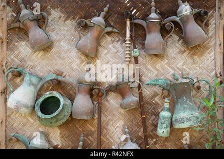 Selection of traditional Arabic coffee pots on display at the Rashid al Oraifi House Museum, Muharraq, Kingdom of Bahrain - Stock Image