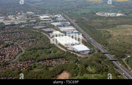 aerial view of Birchwood Technology Park and the M62 motorway at Birchwood, Warrington, showing junction 11 in the right foreground, Cheshire - Stock Image