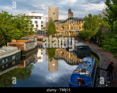 London, England, UK - May 2, 2019: Houseboats are moored in the Grand Union Canal at Ladbroke Grove in west London. - Stock Image