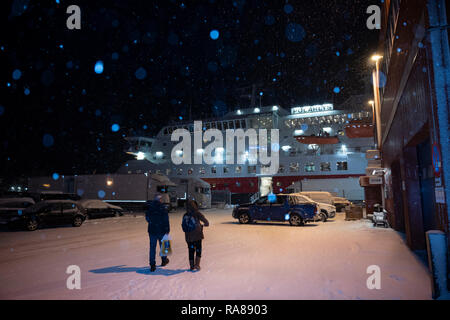 Passengers returning to the Hurtigruten MS Polarlys at Honningsvag, Norway. - Stock Image