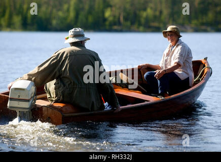 Seniors in a small boat - Stock Image