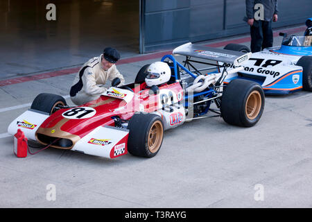 Julian Stokes sitting in his Red, 1970, Tecno Historic Formula 2 Race car, during the 2019 Silverstone Classic Media Day - Stock Image