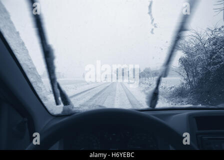 drive on snowy road in winter - Stock Image
