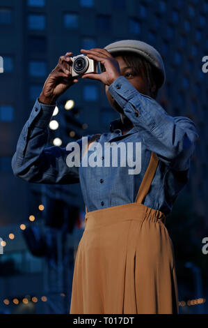 Montreal,Canada.A young woman taking a picture - Stock Image