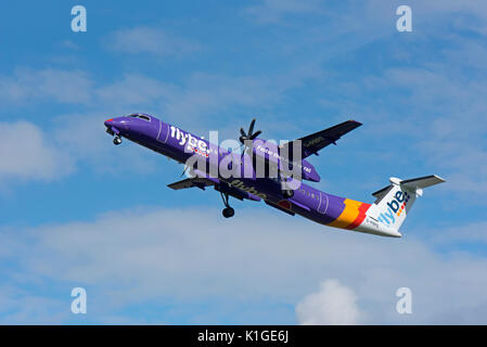 Bombardier Dash 8 Q400 departing Inverness airport in the Scottish Highlands. - Stock Image