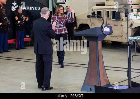 U.S. First Lady Melania Trump waves to guest attending a Toys for Tots Christmas Event at Joint Base Anacostia-Bolling December 11, 2018 in Washington, DC. Toys for Tots is a Marine Corps Program that collects new unwrapped toys and distribute those toys to less fortunate children at Christmas. - Stock Image
