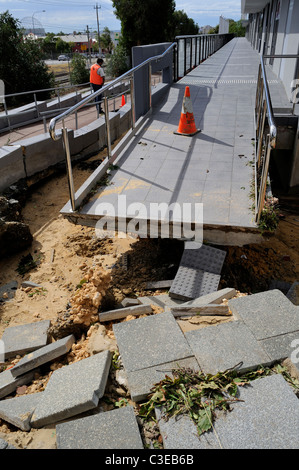 footpath and walkway washed away by flash flood - Stock Image
