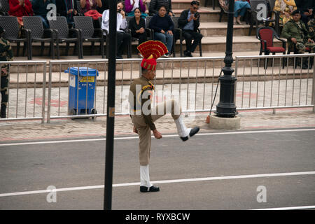 A soldier marches at the Attari-Wagah border closing ceremony the day after the Jaish-e-Mohammed terrorist attack in Indian-administered Kashmir. - Stock Image