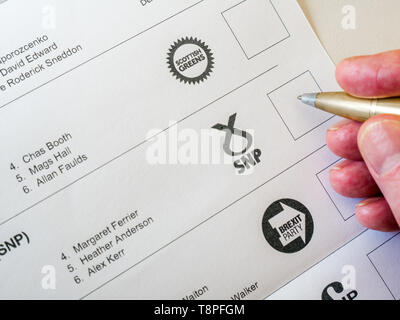 Man voting on ballot paper for Scottish National Pparty (SNP) in European Parliament election, Scotland, May 2019 - Stock Image