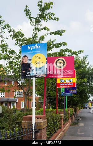 Property for sale and to let signs from a variety of estate agents outside a block of modern apartments, Hatherton Court, Worsely Road North, Walkden, - Stock Image