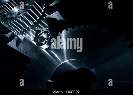 cogwheels, gears and bearings made of titanium and steel - Stock Image
