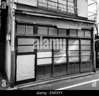 Tatami shop in Yotsuya, Tokyo, Japan closed for a public holiday. The door has been repaired with duck tape - Stock Image