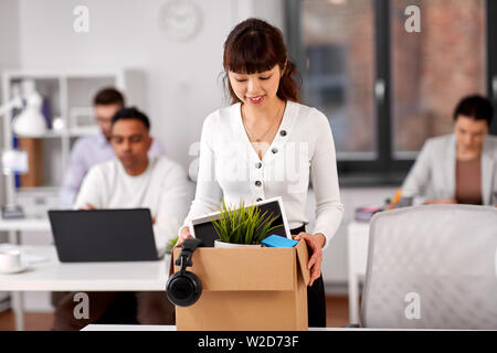 female employee with personal stuff at office - Stock Image