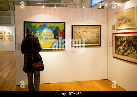 Mercer Art Gallery in Harrogate interior with s senior lady visitorviewing art work about the town - Stock Image