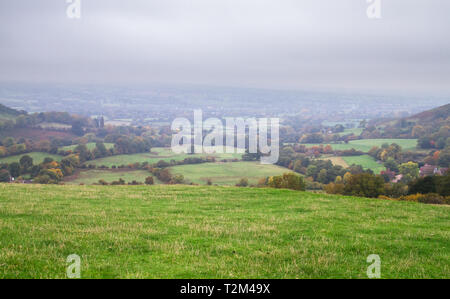 Agricultural land for sheep grazing is seen on a foggy day in rural Shropshire, England. - Stock Image