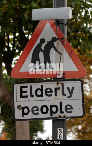Elderly People sign in poor state of repair: symbolic of neglect. - Stock Image