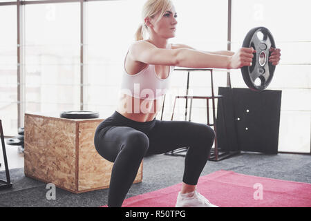 Woman lifting weights in gym Concept workout healthy lifestyle sport - Stock Image