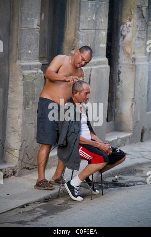 Street scene in Havann Viejo,open air hair cutter, Havanna Cuba - Stock Image