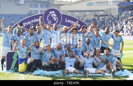 Manchester City celebrate winning the title during the Premier League match between Brighton & Hove Albion and Manchester City  at the American Express Community Stadium 12 May 2019 Photograph taken by Simon Dack  Editorial use only. No merchandising. For Football images FA and Premier League restrictions apply inc. no internet/mobile usage without FAPL license - for details contact Football Dataco - Stock Image
