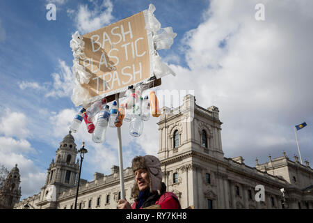 On the occasion of Commonwealth Day, an environmental activist stands outside the Treasury Office in Parliament Square, advocating the ban on plastics around the world, on 11th March 2019, in Westminster, London, England. - Stock Image