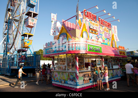 Children place their order at a food vendor stand during a carnival in Rogers, Arkansas. - Stock Image