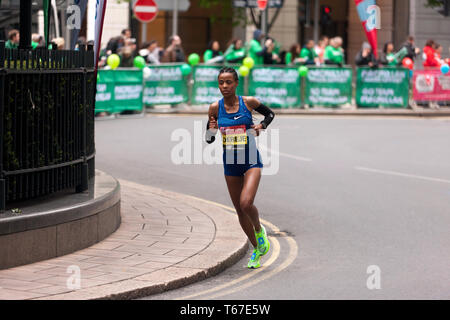 Elite Female Athlete, Roza Dereje competing for Ethiopia in the 2019 London Marathon. She finished 3rd, in a time of 02:20:51 - Stock Image