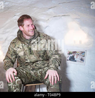 Prince Harry sits in an igloo and gazes at a photograph of himself and his wife Meghan Markle, Duchess of Sussex, from their wedding day.  Prince Harry, Captain General of the Royal Marines, visits Bardufoss Air Force Base on the 50th anniversary of Operation Clockwork, the Arctic warfare training exercise.  Featuring: Prince Harry, Harry Duke of Sussex Where: Bardufoss, Norway When: 14 Feb 2019 Credit: John Rainford/WENN - Stock Image