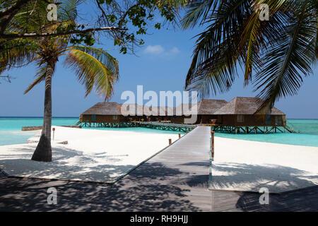 Maldives holiday resort; overwater villas, Velingandu island, Rasdhoo atoll, The Maldives Asia - Stock Image