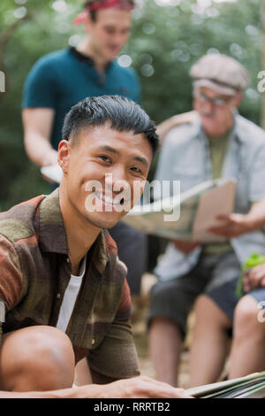Portrait confident man with map, preparing for hike - Stock Image