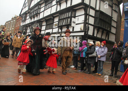 Rochester, Kent, UK. 1st December 2018: A couple dressed in Victorian costume participate in the Main parade on Rochester High Street. Hundreds of people attended the Dickensian Festival in Rochester on 1 December 2018. The festival's main parade has participants in Victorian period costume from the Dickensian age. The town and area was the setting of many of Charles Dickens novels and is the setting to two annual festivals in his honor. Photos: David Mbiyu/ Alamy Live News - Stock Image