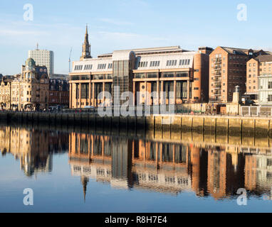 Newcastle crown court building reflected in the river Tyne, north east England, UK - Stock Image