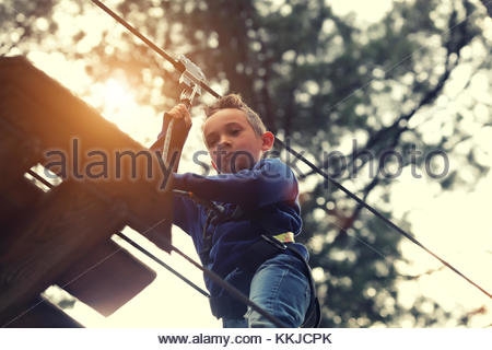 boy on zip line - Stock Image