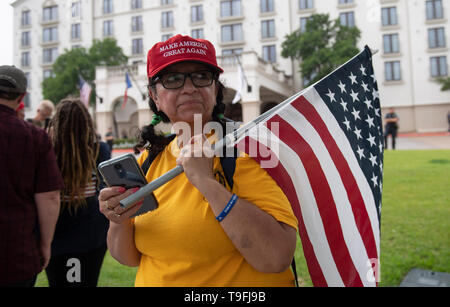Protesters rally outside the Austin, Texas, hotel where controversial Muslim Congresswoman Ilhan Omar spoke at a city-wide iftar dinner, and use cell phones to record the proceedings. Omar has been accused of making anti-Semitic remarks. - Stock Image