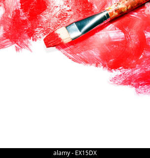 Stock image of paintbrush and red paint strokes over white canvas with copy space - Stock Image