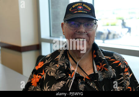 Retired Master Sgt. Don Benton, former Air Force Band French horn player, poses for a photo during the Retiree Appreciation Day event at Buckley Air Force Base, Colorado, Aug. 25, 2018. Benton initially served in the U.S. Army during the Vietnam War before transferring to the Air Force. He said the military brought him many opportunities to travel overseas and stateside, and he was thankful for the ability to do what he loved. (U.S. Air Force photo by Senior Airman Jazmin Smith) - Stock Image