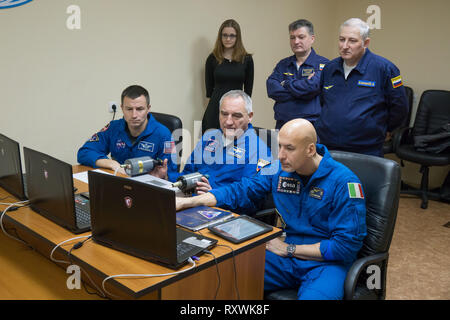 International Space Station Expedition 59 backup crew members Drew Morgan of NASA (left), Alexander Skvortsov of Roscosmos (center) and Luca Parmitano of the European Space Agency (right) rehearse rendezvous and docking techniques on a laptop computer simulator during pre-launch training at the Baikonur Cosmodrome March 7, 2019 in Baikonur, Kazakhstan. Expedition 59 crew: Christina Koch of NASA, Alexey Ovchinin of Roscosmos, and Nick Hague of NASA will launch March 14th onboard the Soyuz MS-12 spacecraft for a six-and-a-half month mission on the International Space Station. - Stock Image