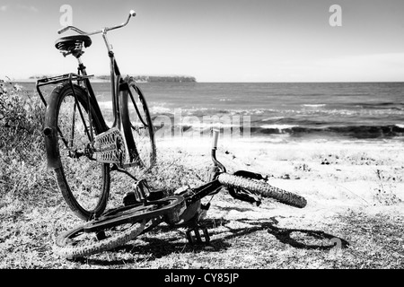 Two bicycles on the beach of Djupvik, Gotland, Sweden. - Stock Image