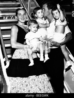 Singer PAT BOONE and wife Shirley Lee Foley, and three of their four daughters prepare to board a TWA flight in - Stock Image