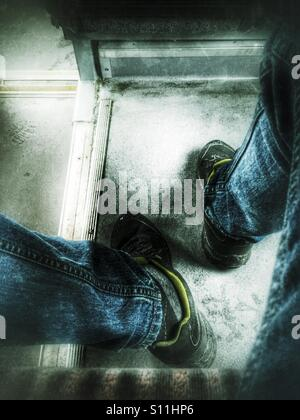 Legs, sitting in the buss - Stock Image
