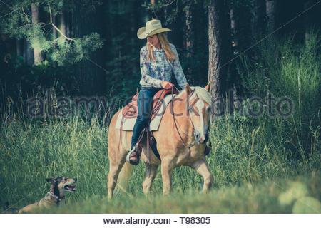 A cowgirl rides through heartland part 2 - Stock Image