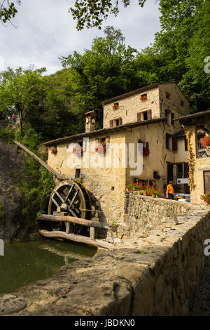 Colorful cottage with water mill - Stock Image