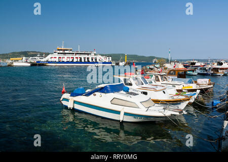 CANAKKALE, TURKEY - AUGUST 14, 2017: Fishing boats in the Canakkale harbor, Turkey. Canakkale town waterfront. - Stock Image