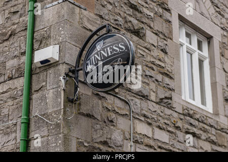 Guinness sign outside an Irish pub. - Stock Image