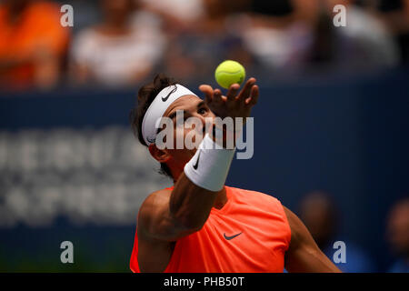 Flushing Meadows, New York - August 31, 2018: US Open Tennis:  Number 1 seed Rafael Nadal serving to his opponent Karen Khachanov of Russia during their third round match at the US Open in Flushing Meadows, New York. Credit: Adam Stoltman/Alamy Live News - Stock Image