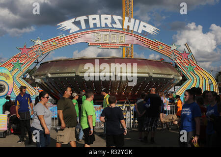 Starship 3000 carnival ride. Crowd of people in the foreground. Canfield Fair. Mahoning County Fair. Canfield, Youngstown, Ohio, USA. - Stock Image