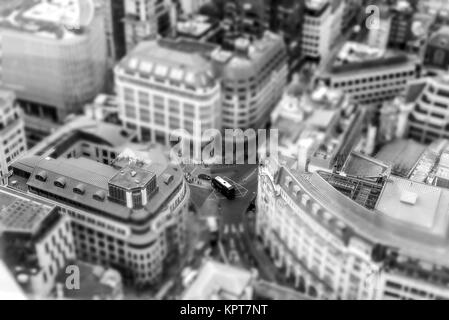 Ariel view of London City in England with various buildings and busy streets with intentional tilt shift effect - Stock Image